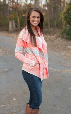 The Neon Snowflake Cardigan features a cascading open front and Aztec inspired snowflake detail.