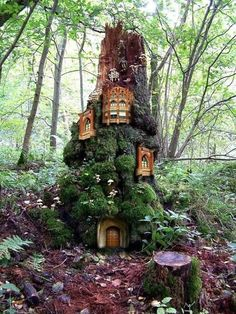 Fairy garden apartment building on tree stump with moss
