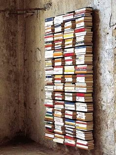 Invisible wall-mounted bookshelves turn a library into wall art... B L O O D A N D C H A M P A G N E . C O M: