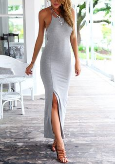 Girl in long grey front-slit dress and strappy sandals