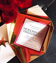 If only I was doing paper invitations... these Hollywood Halloween invites in red and gold are cute!