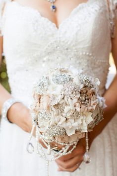 Handmade flowers and broach wedding bouquet. See all our bouquet jewelry here: http://www.lightsforalloccasions.com/c-524-corsage-bouquet-supplies.aspx