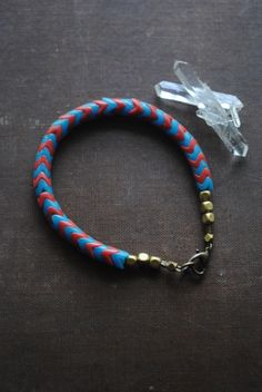 """Chevron style Red and Blue Unisex  Bracelet/  by ArcaneMemory  """"Snake Dreams""""  vintage African trade beads called snake beads paired with brass nuggets and a lovely heart-shape clasp.  These bead are highly sought after and in fashion these days. If you would like to know more have a look at my shop; arcanememory.etsy.com"""