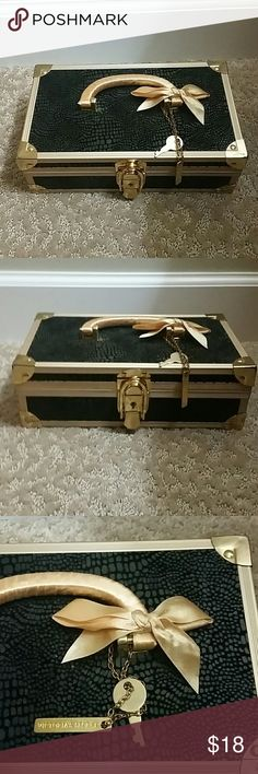Rare victoria Secret locked jewelry box It's been used and has some signs of it but overall is in really good condition. Outside is a textured snake skin material and inside is leopard print. It has a lock and key. Other