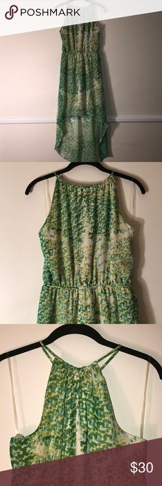 Green Speckled Asymmetrical Dress Asymmetrical length dress. Green and blue speckled pattern throughout with adjustable crop neckline. Elastic waistline creates billowing top and shows off shape! Cream colored lining. Romeo & Juliet Couture Dresses Asymmetrical