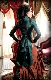 Emerald green open bust tailcoat.