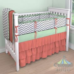 Nursery Crib bedding in White and Gray Zig Zag, Solid Mint, Solid Coral. Created using the Nursery Designer® by Carousel Designs where you mix and match from hundreds of fabrics to create your own unique baby bedding.