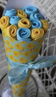 Baby shower bouquet. Onsies, blankets, etc rolled up like flowers. Very cute