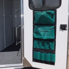 """- Part #: OTP-TRO-2048 - Description: 1 (one) - 20""""x48"""" Tack Organizer made of sturdy Black Nylon with Green mesh pockets. A 1 1/2"""" Nylon strap is sewn around the edges for extra reinforcement. Six me"""