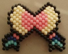 Sylveon pokemon kandi bow $10.00 This Kandi bow is Pokemon themed! Do you love bows and beads? Now you can have both. This bow fits in the palm of your hand and secures to your hair with an alligator clip. Hand-made with TLC. pink, cream, and blue, with black outlines http://sillybunnybeads.storenvy.com/products/10148604-sylveon-pokemon-kandi-bow