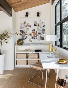 The second-floor mezzanine now hosts a chic home office that looks out onto the roof terrace. Tagged: Office, Lamps, Study, Chair, Desk, Shelves, Bookcase, Storage, and Rug Floor. Photo 12 of 17 in A 1957 Midcentury in Seattle Receives a Striking Makeover