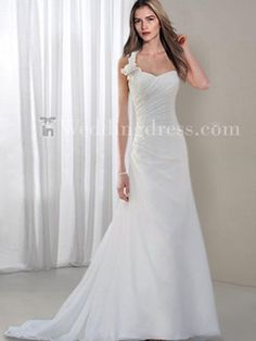 Chiffon Gown with Asymmetrical Wrap with a Hint of Sparkle and Detailed Flower Accent.