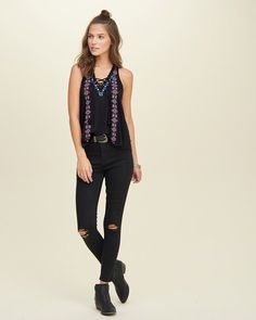 Detailed with ethnic embroidery and a lace-up neckline, featuring tassel ties.