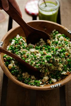 Spring Couscous Salad with Basil Vinaigrette - A simple spring salad with lots of walnuts, couscous, peas, and feta cheese. All dressed with a simple basil vinaigrette. #basilvinaigrette #peasalad #couscoussalad #vegetarian   Littlespicejar.com