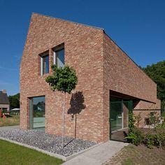 Home in Belgium by Joris Verhoeven features handmade bricks and a lopsided roof