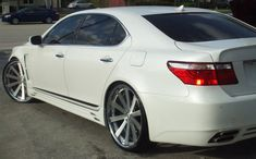 LS - Gen - with custom wheels - Here is a Lexus with 24 Forgiato Concavo wheels. They are custom built 3 piece wheels by Forgiato. Aichi, Lexus Ls 460, Car Tags, Lexus Cars, Custom Wheels, Hot Rides, Japanese Cars, Toyota Camry, My Ride