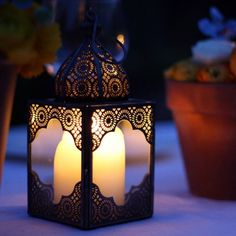 Moroccan table lamp - Adding a lamp is a way people incorporate Moroccan style to their homes. All Moroccan lamps will differ little from each other. Moroccan Table Lamp, Moroccan Lanterns, Moroccan Decor, Wedding Table Centres, Wedding Table Centerpieces, Wedding Decorations, Small Lanterns, Candle Lanterns, Moroccan Design