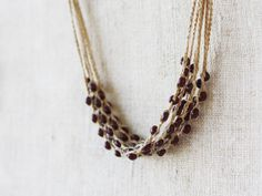 Linen necklace crocheted with brown opaque glass beads