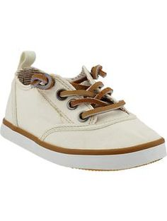 These lil canvas dress shoes would look cute with some khaki colored chino's & a collared shirt for the lil man! (: