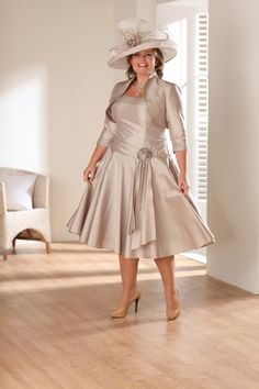 """<p><span style=""""font-style: italic; font-weight: bold;"""">Below the knee dress with wide shoulder straps in café latte. The style of the dress gives a slimming effect by drawing in the waist and adds volume to the skirt. Comes with a matching bolero in three quarter length sleeves. Full sleeves available if required.</span></p> <div> <div><span><strong><em>The colour palette for this style is simply ..."""