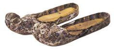 Tang Dynasty. A variant of the treasure-patterned brocade shoes with toe caps shaped in cloud patterns. Relic unearthed in Asitana, Turfan, Xinjang Uygur Autonomous Region. [Figure 178 in 5000 Years of Chinese Costume0