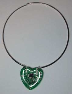 The Heart Spark - a heart-shaped pendant which flashes LEDs in time with your heart beat.