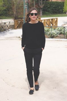 Black tailored trousers and jumper/sweater.