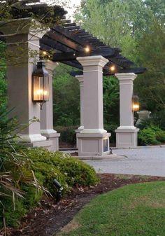 Love the pergola and gas lanterns. Pergola Attached To House, Deck With Pergola, Backyard Pergola, Backyard Landscaping, Black Pergola, Steel Pergola, Farmhouse Landscaping, Attached Garage, Pergola Swing