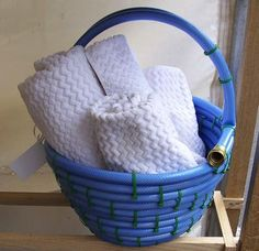 Make a basket from a garden hose! Make sure to let the hose sit in the sun for several hours so it's more pliable and easy to work with!