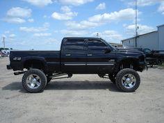 Lifted jacked Chevrolet Silverado truck