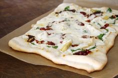 Sun Dried Tomato & Spinach Pizza with Artichoke Hearts.  I will use the homemade alfredo sauce recipe and pizza dough from Trader Joes.