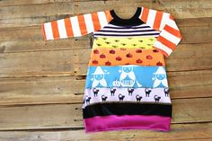 How to make an upcycled t-shirt dress AND how to stamp fabric.   Lots of good ideas here. via lilblueboo.com