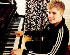Justin Bieber playing piano