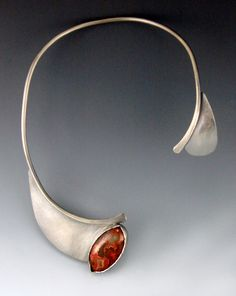 Collar necklace | Wendy Edsall-Kerwin.  'Eye of Kali'.  Sterling silver, flaming Lake Superior Agate