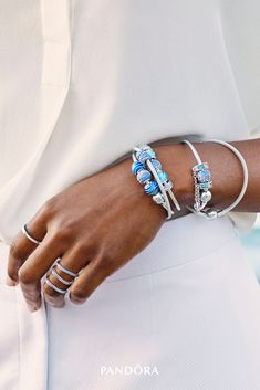 Make a splash with aquatic new jewellery in sterling silver. Create perfect pairings with colourful stone-embellished charms and classic bracelets or create sophisticated stacks with pastel-hued rainbow rings.