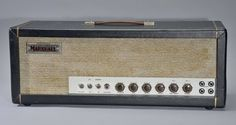 """The JTM 45 was introduced in 1962, handmade in an all-aluminum chassis, by Ken Bran and Dudley Craven. Because of its power, Marshall decided early on to build it as a head, with a separate 4×12"""" cabinet with Celestion speakers. The amplifier itself was based on the Fender Bassman. It uses KT66 vacuum tubes although early versions had used US 5881, a version of the 6L6 and 12AX7 tubes also known in Britain as ECC83 valves in the pre-amp stage. Significant differences between the Bassman…"""