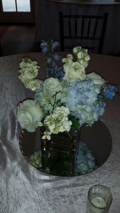 Centerpiece from recent wedding.Blue , yellow and ivory.Suzy -Moonflower Cottage.