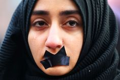 A Turkish student cries during a protest to show solidarity with trapped citizens of Aleppo, Syria, in Sarajevo, Bosnia and Herzegovina.