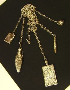 Fancy Antique Sterling Chatelaine with Many Accessories.  Hallmarked JR/SJ.  Match holder, Fancy Note Pad, Scent Bottle, Pencil, Etc.  Fancy Filigree.  Elaborate