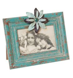 Teal antiqued frame with metal flower