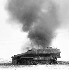 A German half-track armored command vehicle Sd.Kfz. 251/6 Ausf. C on fire after US troops torched it. Normandy 1944.