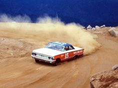 Parnelli Jones powering his Mercury to a class win at the1963 Pikes Peak Hill Climb #ParnelliJones #PikesPeak #PPIHC