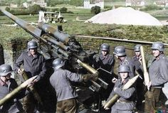 German Luftwaffe ground troops engage enemy airplanes using an flak cannon to shoot them down. Luftwaffe, German Soldiers Ww2, German Army, Germany Ww2, Ww2 Photos, Photographs, Panzer, Military History, Ww2 History