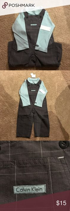 Calvin Klein overall and shirt set 24 mon overall and long sleeve collared shirt combo. New with tags. Shirt is collared and light blue. Overalls are grey with light white stripes/check pattern. Calvin Klein Matching Sets