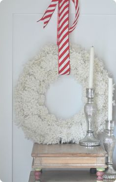 DIY Home Decor | Christmas | Get the tutorial to make an Anthropologie-inspired pom-pom wreath that's perfect for Christmas and winter!