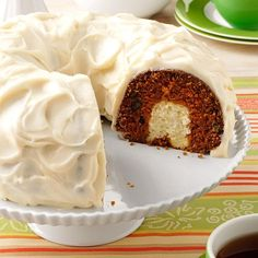 """Surprise Carrot Cake Recipe -A cousin gave me this carrot cake recipe. It's a wonderful potluck pleaser with its """"surprise"""" cream cheese center. My husband and our two young children love it, too! —Lisa Bowen, Little Britian, Ontario"""