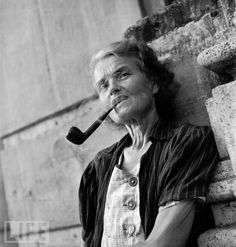 An American woman freed in the February 1945 liberation of Manila's Santo Tomas University, leans against the wall of the college-turned-internment camp as she enjoys her pipe. Face Reference, Reference Images, University Of Santo Tomas, Ww2 Photos, Prisoners Of War, Poses, Drawing Skills, Life Magazine, Wwii