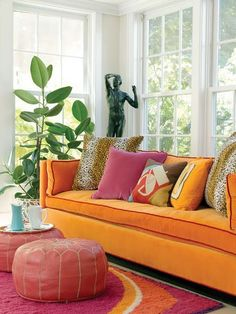 bright colors, lots of pillows in different prints and sizes, poufs