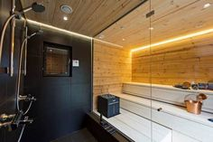 Large glass wall between sauna and shower area creates spacious feeling and lightens up the room. Portable Sauna, Saunas, Comfort Zone, Home Projects, Architecture Design, Kitchen Cabinets, Ceiling Lights, Shower, Interior Design