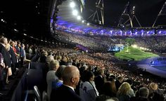 Britain's Queen Elizabeth (2nd L), stands during the opening ceremony of the London 2012 Olympic Games at the Olympic Stadium July 27, 2012.